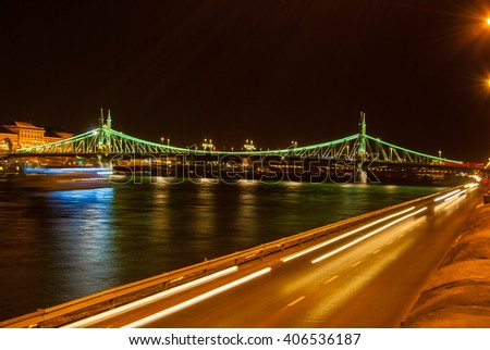 Liberty bridge in Budapest - Hungary. With car lights on street.  Background for transportation in Europe. - stock photo