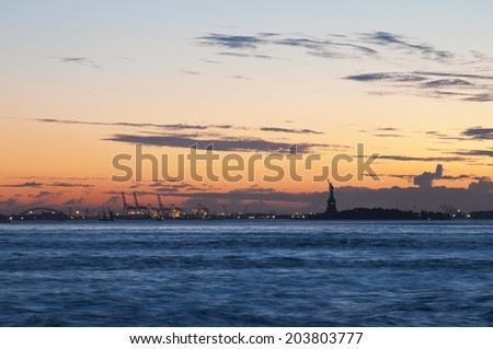 Liberty Island and Harbour of New Jersey at evening after sundown, New York, USA - stock photo