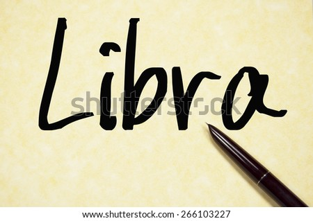 libra word write on paper  - stock photo