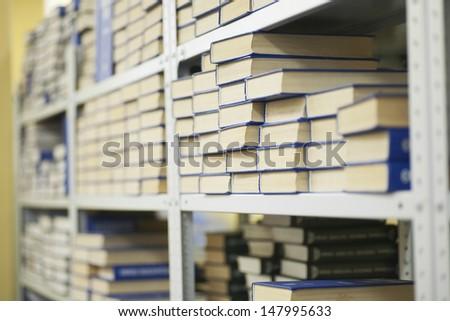 Library books on shelves - stock photo