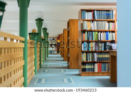 Library bookshelf extreme closeup with letter sign - stock photo