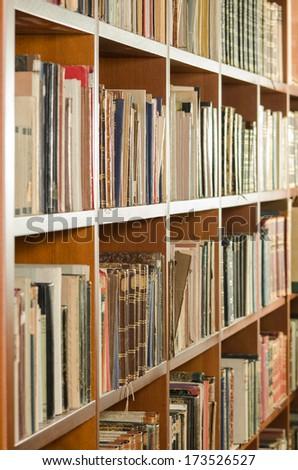 Library bookshelf side view - stock photo