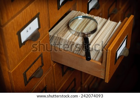 Library Card Catalog Drawer Magnifier Glass Search Concept Stock Photo - stock photo