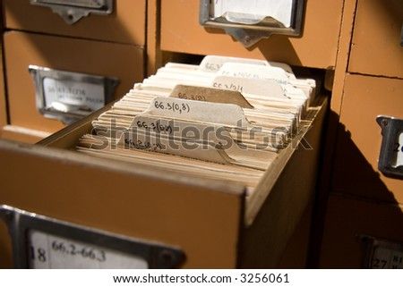 Library catalogue close view. Morning yellowish sunlight. - stock photo