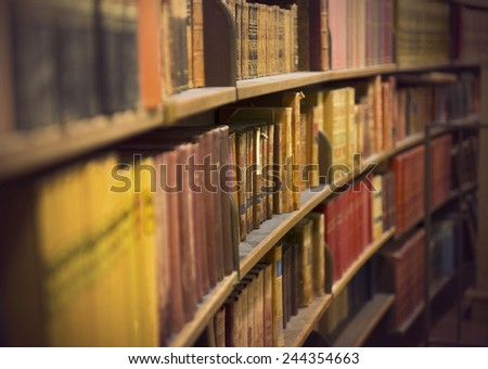 Library or book store with rows of old antique books - stock photo