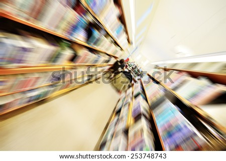 Library shelf, zoom blurred - stock photo