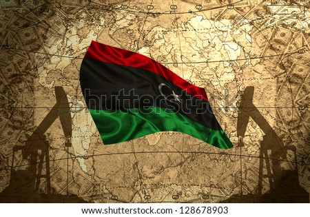 Libya flag on the background of the world map with oil derricks and money - stock photo