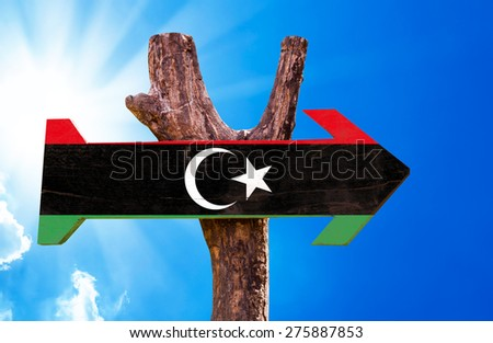 Libya Flag wooden sign with sky background - stock photo