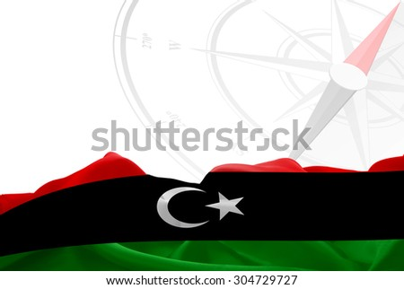 Libya High Resolution flag and Navigation compass in background - stock photo