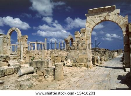 Libya. Leptis Magna. Arch of Tiberius over the Cardo street - stock photo