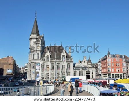 LIEGE, BELGIUM-OCTOBER 19, 2014: Shopping area in center of Liege during Sunday market. Current population of the city is about 200000 persons - stock photo