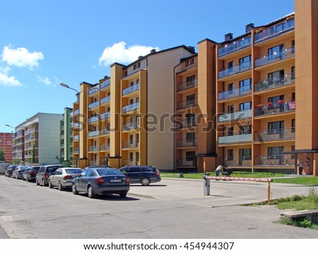LIEPAJA, LATVIA - JULY 19, 2016: On Daugava street newly built apartment houses have separate individual marked parking places with electronic lifting barrier and radio trigger. - stock photo