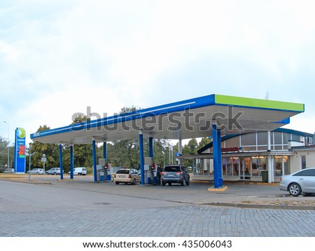 LIEPAJA, LATVIA - JUNE 10, 2016: One of company Neste fuel stations is located on Barinu street and works automatically without operator.                                - stock photo