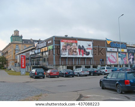 LIEPAJA, LATVIA - JUNE 10, 2016: Shopping center Ostmala is located on Barinu street and has one of company Rimi stores in it.                                - stock photo