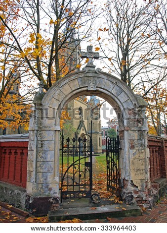 LIEPAJA, LATVIA - NOVEMBER 1, 2015: Old historical church gates with iron grid and brick arch are located on Rakstvezhu street. - stock photo