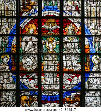 LIER, BELGIUM - MAY 16, 2015: Stained Glass window (1450) in St Gummarus Church in Lier, Belgium, depicting the Coronation of Mary - stock photo