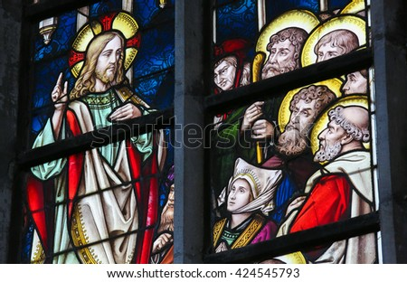 LIER, BELGIUM - MAY 16, 2015: Stained Glass window in St Gummarus Church in Lier, Belgium, depicting the Sermon on the Mount - stock photo