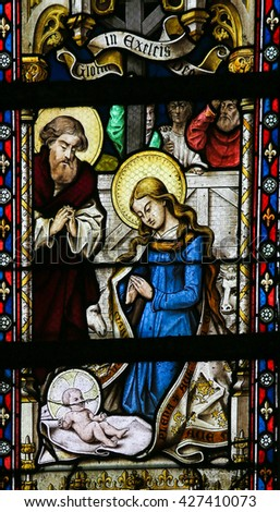LIER, BELGIUM - MAY 16, 2015: Stained Glass window in St Gummarus Church in Lier, Belgium, depicting a Nativity Scene at Christmas - stock photo