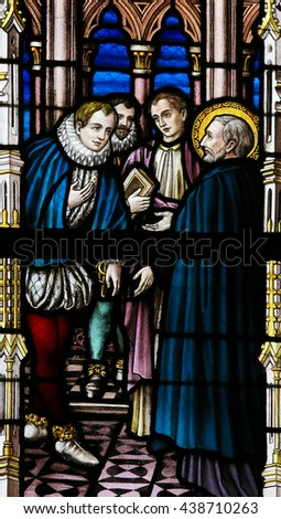 LIER, BELGIUM - MAY 16, 2015: Stained Glass window in St Gummarus Church in Lier depicting a meeting of Saint Francis Xavier, a Roman Catholic missionary and Martim Alfonso de Souza, governor of India - stock photo