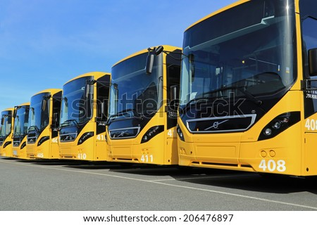 LIETO, FINLAND - APRIL 5, 2014: Row of yellow Volvo 8900 intercity buses parked on a yard. The 8900 has a Volvo D8K Euro 6 engine, which is one of the world's most fuel-efficient bus diesel engines.  - stock photo