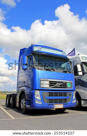 LIETO, FINLAND - AUGUST 31, 2013:  Blue Volvo FH 480 truck parked. The tractor unit belongs to the upgraded second version of Volvo FH and FH16 Mk. II, manufactured between 2008 and 2012.  - stock photo