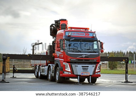 LIETO, FINLAND - NOVEMBER 14, 2015:  Volvo FM 500 equipped with heavy crane of ST-Trans is displayed at the Volvo Truck Center Turku Demo Drive and Tire Service Event. - stock photo