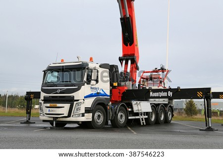 LIETO, FINLAND - NOVEMBER 14, 2015:  Volvo FM equipped with Palfinger heavy crane of Mountplan Oy is displayed at the Volvo Truck Center Turku Demo Drive and Tire Service Event.   - stock photo