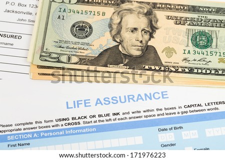 Life assurance application form with banknote concept for life planning - stock photo