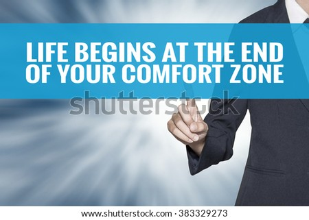 Life Begins at the end of Your Comfort Zone word on virtual screen touch by business woman cyan sky tab - stock photo