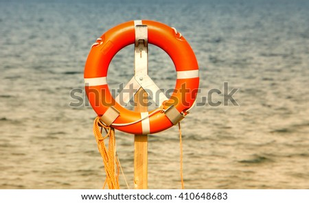 life belt, rescue ring, water in background - stock photo
