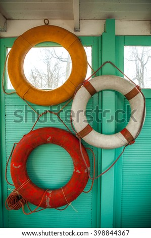 Life belts on wall as decoration. - stock photo