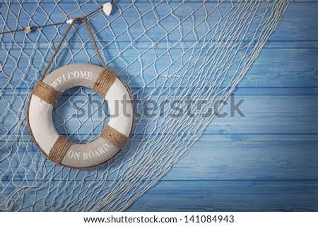 Life buoy decoration on blue shabby background - stock photo