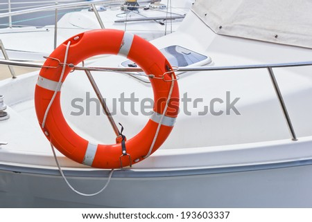 life buoy on boat - stock photo