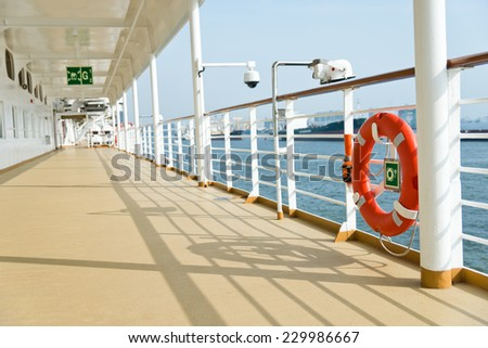 Life buoy on the deck of cruise ship. - stock photo