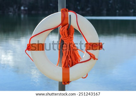 life buoy on the norwegian fjord or on alpine lake - stock photo