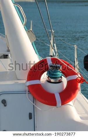 Life buoy preserver belt on sailing boat - stock photo