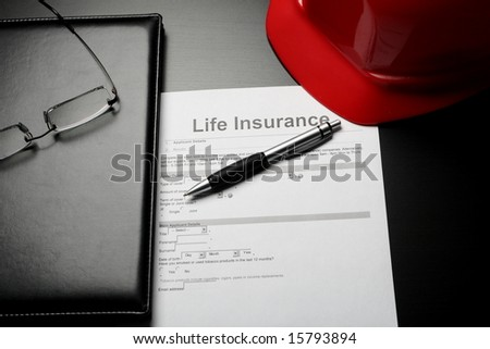 Life insurance concept: document form, pen and red helmet - stock photo