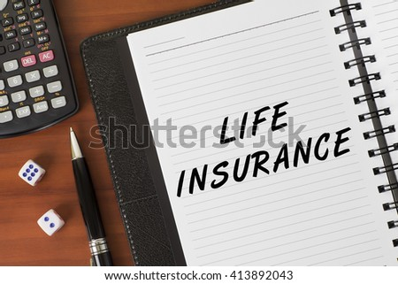 Life Insurance word on a notebook - Finance Conceptual - stock photo