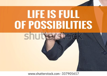 Life is Full of Possibilities word Business man touch on virtual screen orange background - stock photo