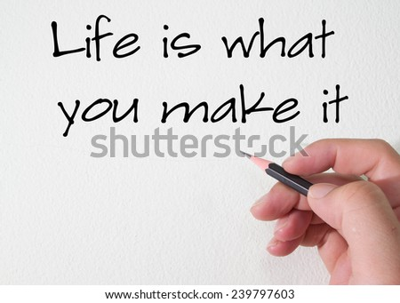 Life is what you make it text write on wall  - stock photo