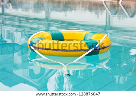 Life preserver floating in a  pool water - stock photo