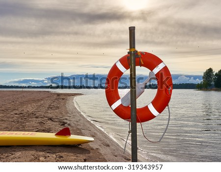 Life Ring in beach on a summer evening. - stock photo