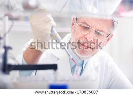 Life scientist researching in laboratory. Life sciences comprise fields of science that involve the scientific study of living organisms: microorganism, plant, animal and human cells, genes, DNA... - stock photo