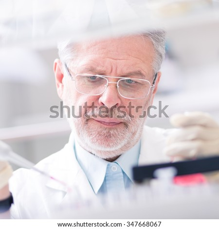 Life scientist researching in laboratory. Life sciences study living organisms on the level of microorganisms, viruses, human, animal and plant cells, genes, DNA... - stock photo