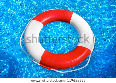 Lifebelt swimming in pool water - stock photo