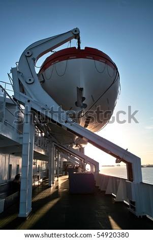 Lifeboat. Emergency boat hung on the davit - stock photo