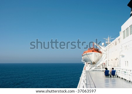 Lifeboat on ship - stock photo