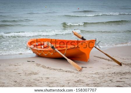 Lifeboat on the Baltic seashore - stock photo