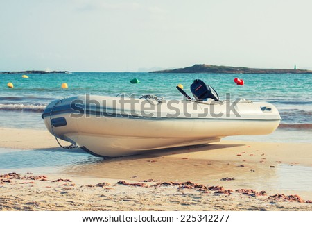 Lifeboat on the beach. - stock photo