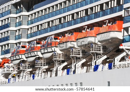Lifeboats on a liner - stock photo